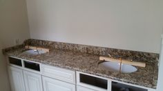 Giallo Napoli granite bathroom vanity install for the Broady family. Knoxville's Stone Interiors. Showroom located at 3900 Middlebrook Pike, Knoxville, TN. www.knoxstoneinteriors.com. Estimates available, call 865-971-5800.