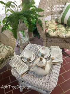 Here's what's common in the South ~ grandma's rocking chair on the porch, sweet tea, slow cooked ribs, green beans with b. Slow Cooked Ribs, Cottage Porch, Ash Tree, Outdoor Furniture Sets, Outdoor Decor, Southern Charm, Rocking Chair, Fern, Tea Time