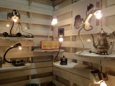"""Dog Tag Designs """"specializes in repurposing and upcycling objects into useful and artistic furnishings."""" Designer Tyagi Schwartz transforms flea market junk — cigar boxes, plastic trucks, gas cans, tins, electric mixers, CB radios, and old rotary phones … lots of lots of old rotary phones — into whimsical lamps."""