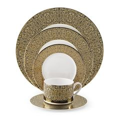 Antonia Dinnerware makes a fashionable, dramatic statement at a formal dining table. These fine bone china pieces feature a luxurious full-coverage gold accented design on a...