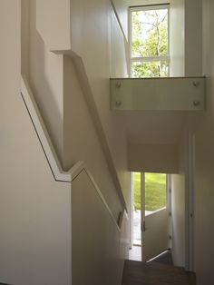 Stair railing recessed into the wall
