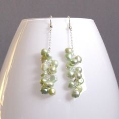 Shanghai - light green pearl earrings.      PorsbyDesign jewelry is handmade jewelry made by Maria Frederiksen. Using mostly fresh water pearls, semi precious stones and sterling silver or gold plate findings.     The jewelry can be used for weddings by brides, bridesmaids, flowergirls or guests; special events or just for everyday use.     I love custom orders so please do get in touch if you have a special request.     Shop: http://porsbydesign.etsy.com