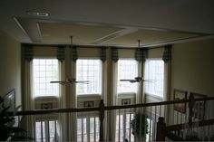 Two-story family room curtain ideas and what to do with that wall in between the top and bottom windows