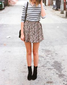 Long sleeved shirt with patterned mini skirt and black shoes
