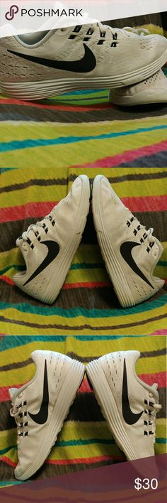 White Nike Running Shoes White Nike Lunartempo Running Shoes. They are very comfortable. I wore them two dozen times. They were well used. I just washed them, therefore they are very clean. Nike Shoes Athletic Shoes