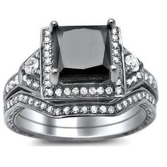 This new certified 1.90ct diamond ring and matching band are set in 14k white gold. An excellent AAA quality 1.52ct solitaire princess cut square diamond is set atop the item. .38cts of white round diamonds surround the solitaire. They are sparkling stones set on the the ring and matching band in a prong and pave setting. The ring's top measures 11.2mm wide along the finger at its largest point. It's accompanied by a full independent gemological laboratory UGL diamond certificate as well as…