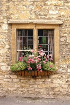 a perfect cottage window accented with flowers...