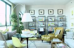 another mid century modern living room. anything done in multiples makes a big impact! (i.e. the bookcases w/ pictures on the focal wall)
