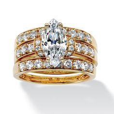<li>Marquise cubic zirconia ring set</li><li>18k yellow gold over silver jewelry</li><li><a href='http://www.overstock.com/downloads/pdf/2010_RingSizing.pdf'><span class='links'>Click here for ring sizing guide</span></a></li>