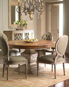 Relaxed dining furniture lends an air of calm and grace to the dining room. Imported. Two-tone dining table is handcrafted of hardwood solids and veneers. 54inDia. x 30inT. Chairs are...