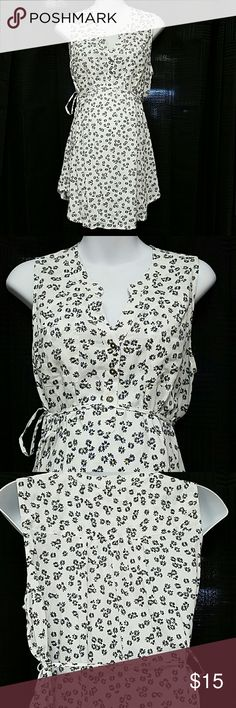 Motherhood Maternity Top Super cute Daisy summer tie waist maternity top. Pleated front and back details. Accent pockets. Half Button neckline. Material is a woven Rayon  (almost Flax or linen like feel) light weight. Flowers are Navy and yellow. Motherhood Maternity Tops Blouses