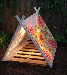 DIY tent for the kids... drill holes and put dowels in the top and bottom. Then throw an old crib mattress in there.