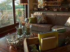 Blurring the line between indoors and out, 16 feet of windows allow sunlight to stream into the space. Candles in clear-glass hurricanes add sparkle without taking up visual space.