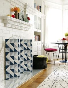 6 Unexpected Uses For Wallpaper: Graphic wallpaper covered fireplace