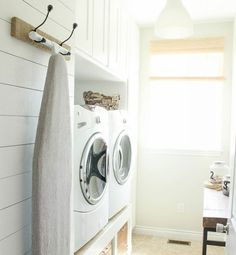 Hang your ironing board to keep your laundry room clutter-free.