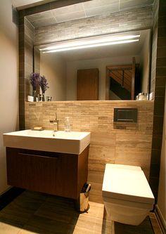 Dark wood, taupe stone and white bathroom