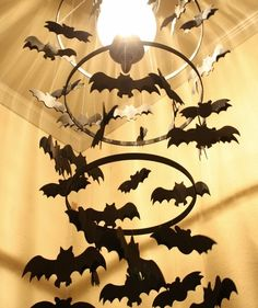 With three different-sized quilting hoops, paper or foam bats, black craft paint, and black string, you can dress up your plain porch light for Halloween. Paint the hoops black and attach them together with string to create a chandelier effect, then hang the bats off the hoops.