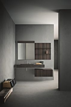 You can see the art of made-in-Italy craftsmanship at work in this modern bathroom design. Many of the details are executed by hand in a perfect synthesis of tradition and innovation, making each piece unique. As typical of modern baths, essential forms define the design while natural materials (wood and stone) intersect with contemporary finishes (cement, glass, lacquer) to create beautiful contrasts.