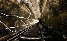 Ghost Tunnel by Jimmy - 500px.com—Popular Images. Description: Located at Helensburgh (south of Sydney AUSTRALIA) this dissused railway tunnel hasnt had a train run through it since 1915. All it has seen since is a mushroom farm, curious kids and a few mugs like me staggering around in the dark with a camera.