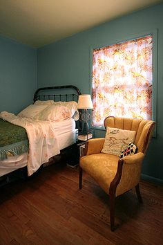 Mustard yellow vintage chair looks great in a blue bedroom.----I want this chair now that our bedroom is blue!