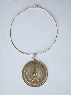 Tapio Wirkkala Finland Necklace and matching earrings, c 1972 Sterling silver Stamped with designer and makers marks Necklace 7 1/2 x 4 1/2