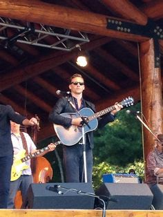 Tom Hiddleston performing at the Wheatland Music Festival 2014.