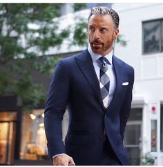 I am loving the peak lapels on this suit...XO Carlos