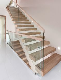 Simple and Modern Staircase Design Ideas (Best for Home and Office) - JJones Glass Stairs Design, Stair Railing Design, Home Stairs Design, Staircase Railings, Wooden Staircases, Interior Stairs, Glass Stair Railing, Stairs With Glass Balustrade, Staircase Design Modern