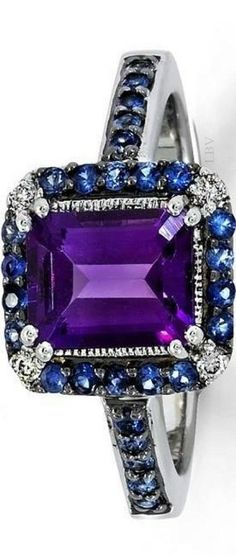 Kind of like this as a unique engagement ring, but with diamonds around the amethyst (halo) and then the diamond and sapphire alternating on the side. Février Collections from The Royale Collections and Company Pvt. Purple Jewelry, Amethyst Jewelry, I Love Jewelry, Fine Jewelry, Jewelry Design, Jewelry Rings, Purple Rings, Silver Rings, Women's Accessories