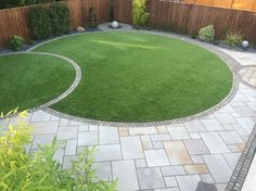 Two overlapping circular lawns with a patio and path (Installed by: Pavex Ltd).