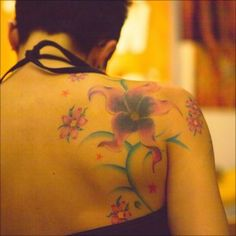 Flower Tattoos – Ideas, Meaning, Flower Tattoo Designs & More…      12           EmailShare  beautiful flower tattoo on calf  Beautiful flower tattoo on woman's calf  Flowers are symbols of beauty. They are symbols of life and sometimes, symbols for death.