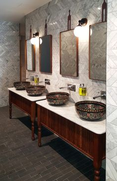 Restrooms at The Island, Gold Coast by Jumble and Stack. Marble Chevron mosaic tiles | Timber and marble vanity | Glazed ceramic vessel basins | Wall mounted glass ball lights | Timber and leather mirrors | Granite brick flooring