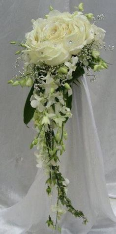 modern twist to a cascade bouquet, composite flower with dendrobium cascade.