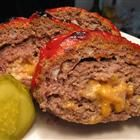 Cheeseburger Meatloaf, different then our usual meatloaf. I layer the meat ten cheese then meat, easier then rolling it.