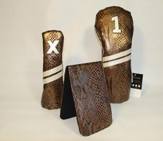 New Bling from Sunfish. Gold python snake skin leather golf headcovers and scorecard / yardage book covers. Call 888-550-3025 to order