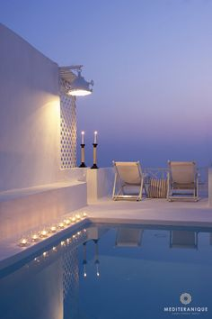 A private terrace with a luxurious candlelit plungle pool, On the Rocks Hotel in Santorini, Greece