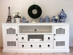 Transform a sideboard into a crisp white delight with paint. Then spray paint its hardware for good measure!