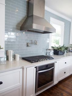 MUST HAVE BLUE SUBWAY TILE fir the kitchen! features in the new kitchen are stainless steel appliances, vent hood and a subway tile backsplash in muted blue – a favorite color of homeowner, Jessica. Blue Subway Tile, Subway Tile Kitchen, Blue Tiles, Subway Tile Colors, Glass Subway Tile, Color Tile, Glass Tile Backsplash, Backsplash Ideas, Tile Ideas