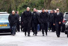 A group of men arrive dressed in black for the funeral of Frankie Fraser