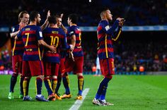 Neymar (R) of FC Barcelona celebrates with his teammates after scoring his team's sixth goal during the La Liga match between FC Barcelona and Celta Vigo at Camp Nou on February 14, 2016 in Barcelona
