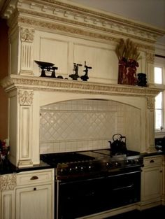 Mantle in the kitchen above the cooktop.