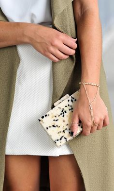 This luxurious resin clutch with a striking speckled print is essential for all your summer events!