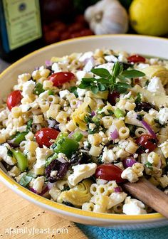 Mediterranean Pasta Salad With Extra-virgin Olive Oil, Chopped Garlic, Fresh Oregano, Kosher Salt, Freshly Ground Black Pepper, Lemon Juice, Ditalini, Lemon, Pitted Kalamata Olives, Grape Tomatoes, Fresh Mint, Fresh Basil Leaves, Purple Onion, Green Bell Pepper, Artichoke Hearts, Feta Cheese Crumbles
