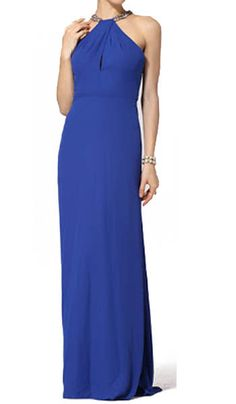 $209.00 Enrapture the room when you make your entrance in this stunning embellished gown.  Round halter neck. Sleeveless. Keyhole at bodice. Embellished halter neck and back straps. Cascading ruffle at back. Slight mermaid hem. Concealed center back zipper with hook-and-eye closure. Crepe: Polyester. Dry Clean. Imported