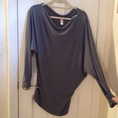 Asymmetric Gray Slouchy Top Asymmetrical design. Super cute with leggings or a belt. Brand new condition, never worn but without tags. Made out of 68% Polyester 28% Rayon 4% Spandex.   NO price negotiations on my listings down below. Click on the OFFER button instead please. NO trades, NO paypal. NO holds. Smoke free home and no pets. Tops