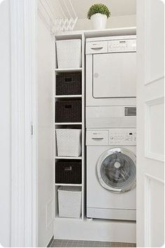 Stacked washer dryer with side storage
