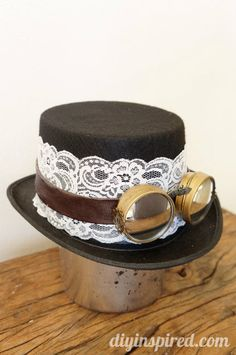DIY Steampunk Top Hat and Goggles - made from an old belt, rear view mirrors, and baby food jar lids #repurposed