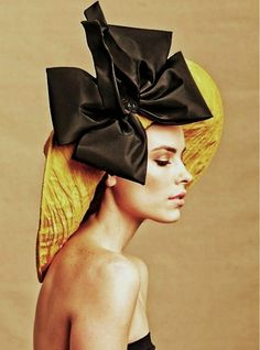My Favorite Hat -- made of golden/yellow crushed taffeta, rolled up with a black couture bow with flexible ties.