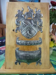 Hand crafted Pewter art family crest on solid wood stand Pewter Art, Going Away Gifts, Metal Embossing, Family Crest, Crests, Coat Of Arms, Corporate Gifts, Wood Doors, Butler