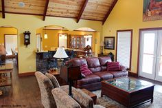 Great Room of The Ryecroft House Plan 824-D - A cathedral ceiling expands the space, while the island kitchen is open to the great room, dining room and breakfast area and features a nearby walk-in pantry. http://www.dongardner.com/images.aspx?pid=1988&fn=interiors\824GreatV2.jpg #Rustic #OpenConcept #FloorPlan